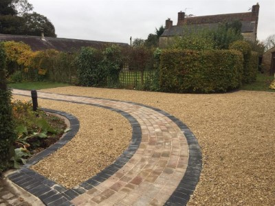 Gold gravel driveway with paved pathway in Somerset