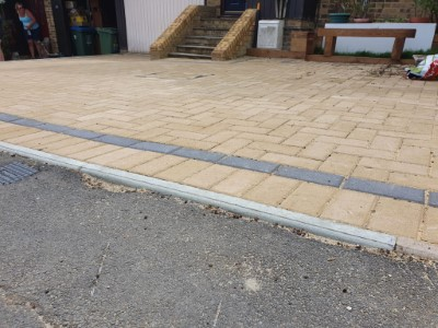 Buff paved driveway with single strip charcoal border
